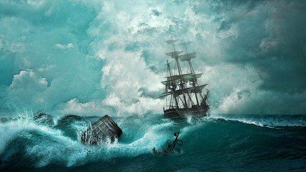 An image of a old ship sailing the ocean.
