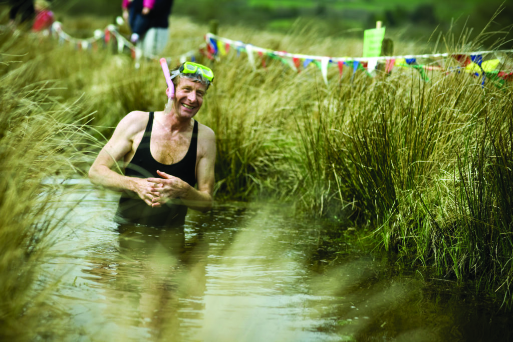 Man swimming in the Bog snorkelling competition