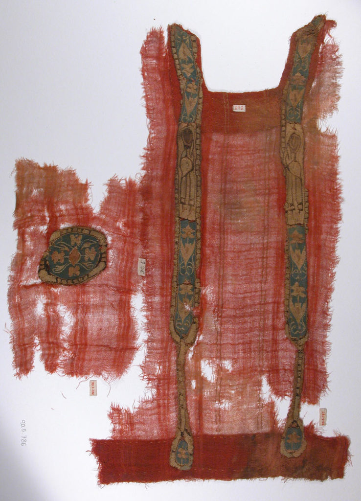 6th to 9th century tunic fragment in the colour red